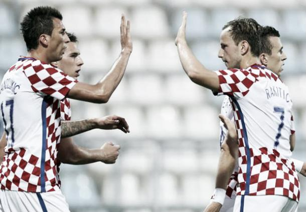Above: Mario Mandzukic and Ivan Rakitic celebrating in Croatia's 10-0 win over San Marino | Photo: AFP / Getty Images