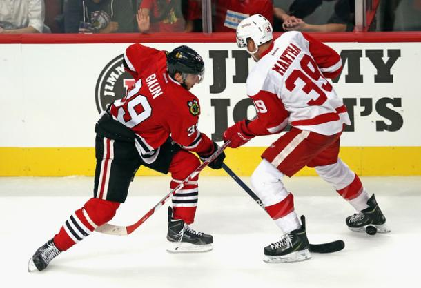 Kyle Baun (39) of Chicago pokes the puck through Anthony Mantha (39) during the preseason, Photo via: Jonathan Daniel/Getty Images
