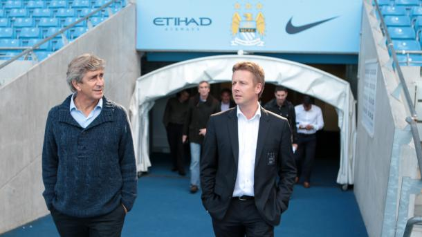 Pellegrini being shown around the Etihad on his first day. (Source: MCFC)