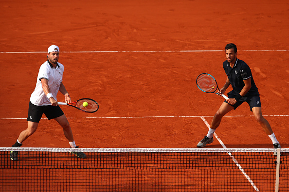 Marach (esq) e Pavic(dir) chegaram à terceira final de major seguida, e ficaram com o segundo vice (Foto: Clive Brunskill/Getty Images)