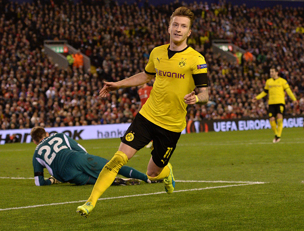 Marco Reus celebrates putting Borussia Dortmund up 3-1 against Liverpool. (Getty)