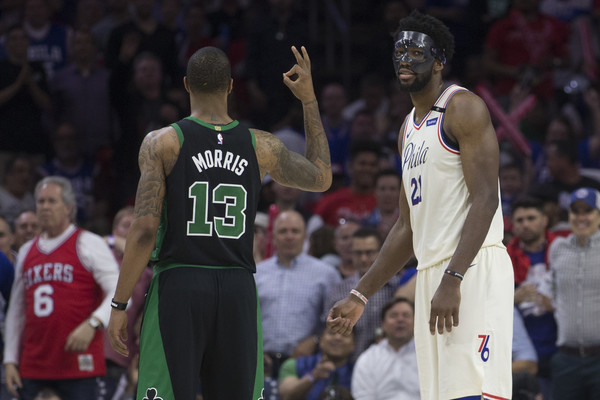 Marcus Morris #13 of the Boston Celtics gestures to Joel Embiid #21 of the Philadelphia 76ers in the third quarter during Game Four of the Eastern Conference Semifinals at the at Wells Fargo Center. |Mitchell Leff/Getty Images North America|