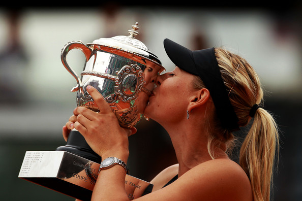 Victory never tasted so sweet: Maria Sharapova kisses the Coupe Suzanne Lenglen after winning the 2012 French Open to complete the Career Grand Slam. She has won just one Grand Slam since then: the 2014 French Open. | Photo: Clive Brunskill/Getty Images