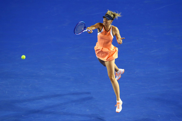 Maria Sharapova hits the ball with much power | Photo: Mark Kolbe/Getty Images AsiaPac