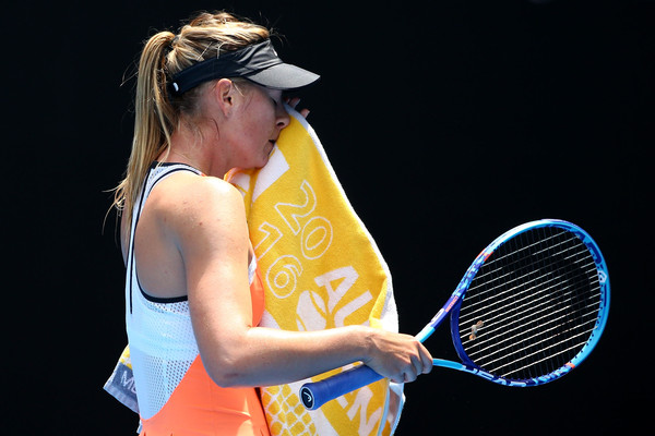 Maria Sharapova towels off during her quarterfinal match against Serena Williams at the 2016 Australian Open, the last match she would play in 2016. | Photo: Scott Barbour/Getty Images