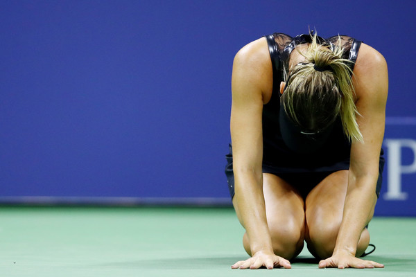 Maria Sharapova celebrates her first round win over Simona Halep | Photo: Clive Brunskill/Getty Images North America