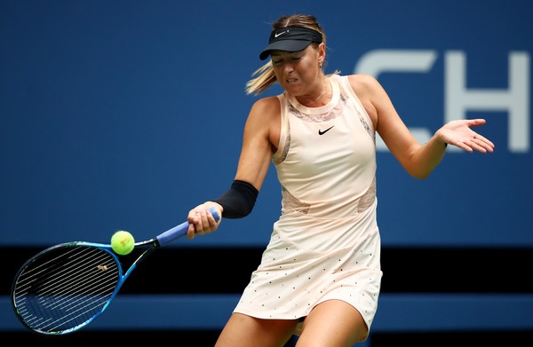 Maria Sharapova playing in her day dress, which would be in action for the second time this week tomorrow against Sevastova | Photo: Clive Brunskill/Getty Images North America