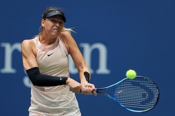 Maria Sharapova hitting a backhand   Photo: Richard Heathcote/Getty Images North America