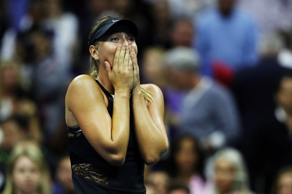 Maria Sharapova was in disbelief after her incredible win over Halep in the first round | Photo: Elsa/Getty Images North America