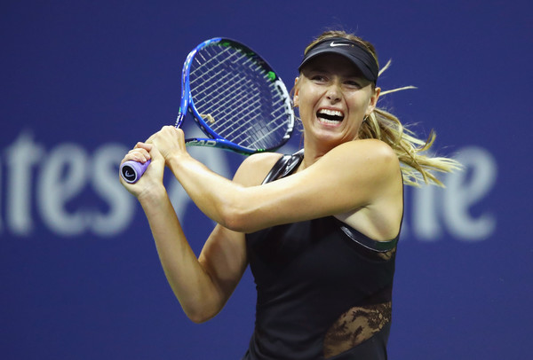 Maria Sharapova hits a backhand during her first-round match against Simona Halep at the 2017 U.S. Open.   Photo: Clive Brunskill/Getty Images