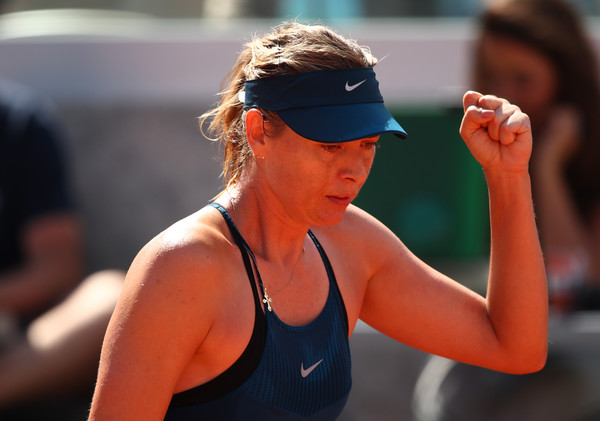 Maria Sharapova produced the massive comeback — rattling off six consecutive games | Photo: Clive Brunskill/Getty Images Europe