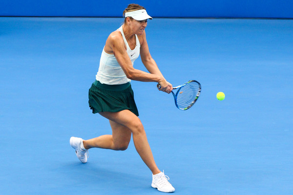 Maria Sharapova in action during her quarterfinal encounter against Zarina Diyas | Photo: Zhong Zhi/Getty Images AsiaPac