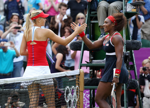 Maria Sharapova and Serena Williams meet at the net after their Gold Medal match | Photo: PacificCoastNews.com