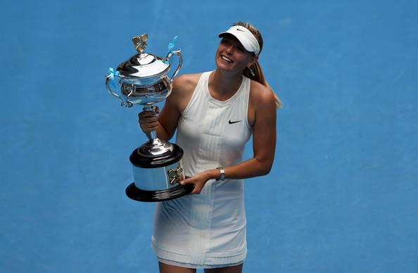 Maria Sharapova with her 2008 Australian Open trophy | Photo: Robert Prezioso/Getty Images AsiaPac