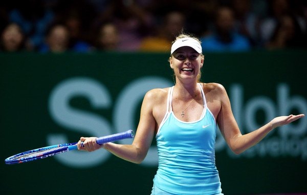 Maria Sharapova celebrates winning her last match against Agnieszka Radwanska | Photo: Clive Brunskill/Getty Images AsiaPac