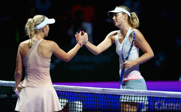Maria Sharapova shakes hands with Caroline Wozniacki after her loss in 2014 at the WTA Finals | Photo: Clive Brunskill/Getty Images AsiaPac