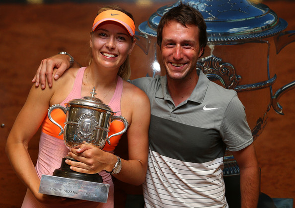 Maria Sharapova and Dieter Kindlmann pose with the Coupe Suzanne Lenglen after Sharapova won her fifth, and most recent, Grand Slam title at the 2014 French Open. | Photo: Clive Brunskill/Getty Images