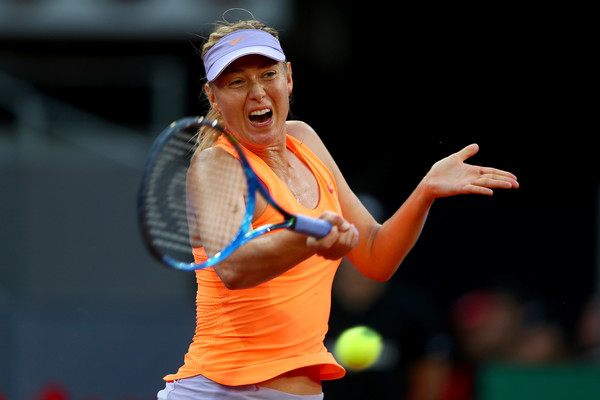 Maria Sharapova hits a forehand during her second-round match against Eugenie Bouchard at the 2017 Mutua Madrid Open. | Photo: Clive Rose/Getty Images