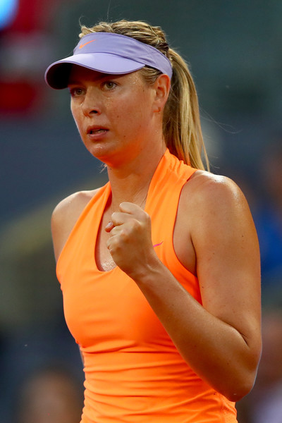 Maria Sharapova celebrates winning the second set 6-2 over Eugenie Bouchard in Madrid | Photo: Clive Rose/Getty Images Europe