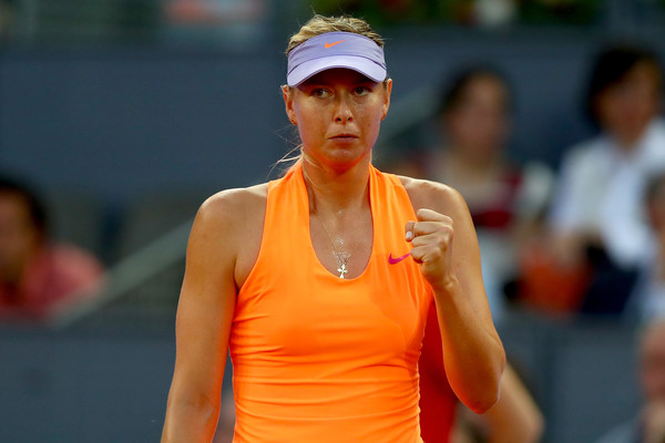 Maria Sharapova celebrates after winning a point during her second-round match against Eugenie Bouchard at the 2017 Mutua Madrid Open. | Photo: Clive Rose/Getty Images