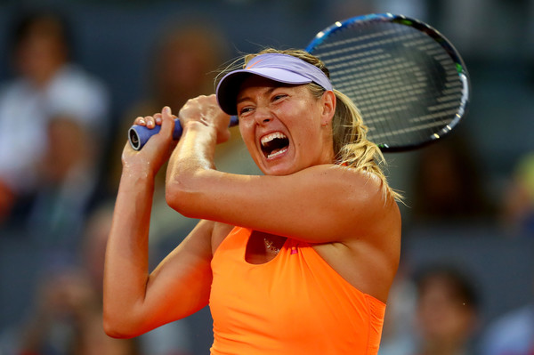 Maria Sharapova hits a backhand at the Mutua Madrid Open against Eugenie Bouchard | Photo: Clive Rose/Getty Images Europe
