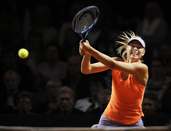 Maria Sharapova hits a backhand during her second-round match against Ekaterina Makarova at the 2017 Porsche Tennis Grand Prix. | Photo: Adam Pretty/Bongarts