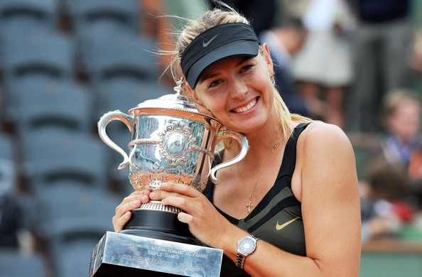Maria Sharapova holding onto her French Open trophy | Photo: Bauer Griffin
