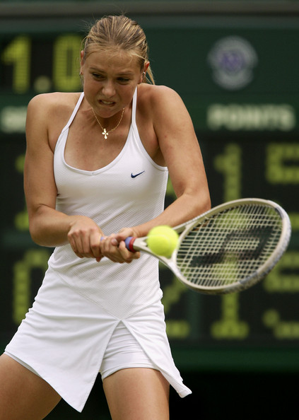 Maria Sharapova in action at the 2004 Wimbledon Championships | Photo: Mike Hewitt/Getty Images Sport