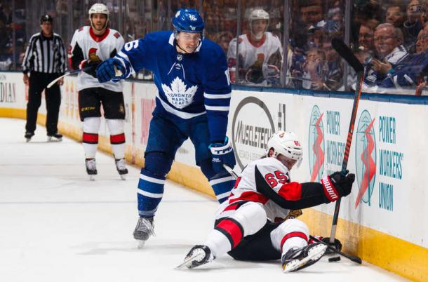 The final goal of the game very much summed up Ottawa's night, as Marner won a battle with Erik Karlsson (on the ice) before setting up Patrick Marleau's empty-netter. Photo: Mark Blinch/NHL via Getty images