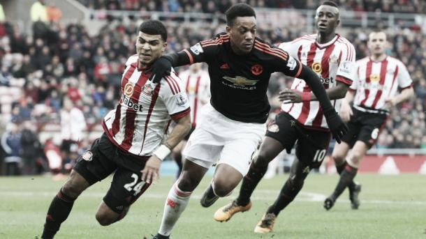 Above: Deandre Yedlin tussling with Manchester United's Anthony Martial after stating that his defending has improved since his move to Sunderland
