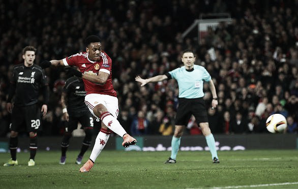 Above: Anthony Martial strikes home in Manchester United's 1-1 draw with Liverpool  photo: Sky Sports