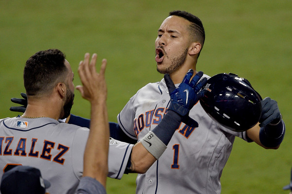 Carlos Correa #1 of the Houston Astros celebrates with Marwin Gonzalez #9 after hitting a solo home run during the tenth inning. |Source: Kevork Djansezian/Getty Images North America|