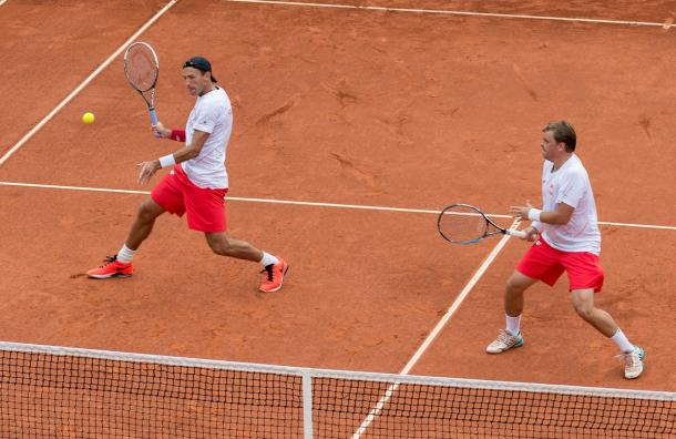 Kubot (left) drills a volley during the Polish comeback. Photo: Davis Cup