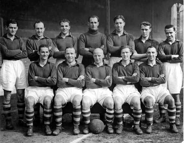 Picture: Matt Busby playing for Liverpool (front row, second left). (Photo via Getty Images)