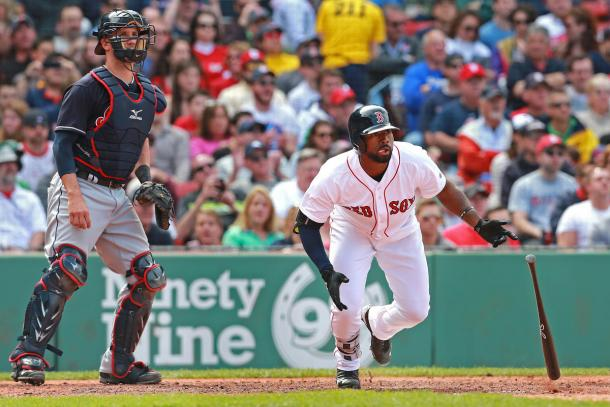 Jackie Bradley Jr. sticks out his tongue after knocking a base hit to right (Matt West/Boston Herald)