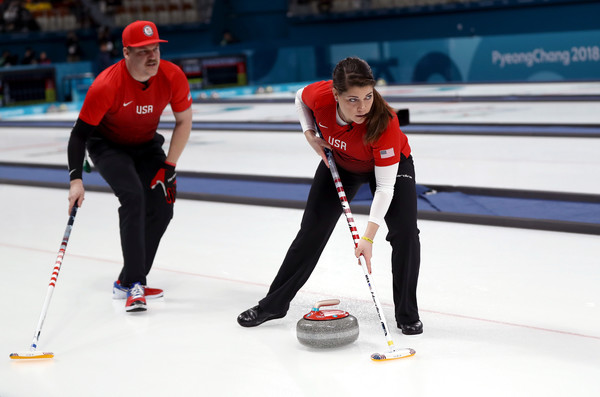 Matt and Rebecca Hamilton deliver a stone down the ice during the Americans' victory over the Olympic Athletes of Russia/Photo: Ronald Martinez/Getty Images