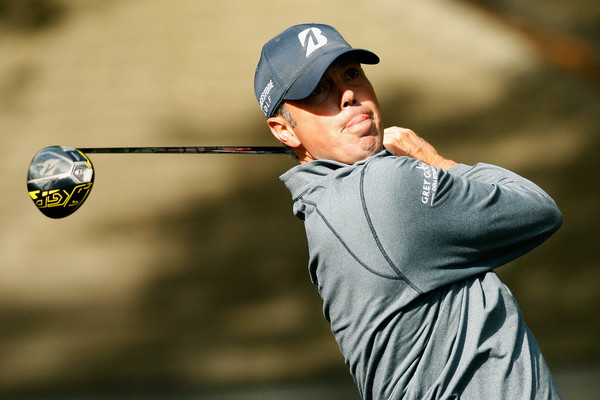 Matt Kuchar watches his drive travel down the fairway. Photo: Tyler Lecka/Getty Images
