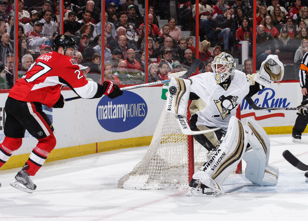Curtis Lazar #27 of the Ottawa Senators tries to tip the puck past the blocker of Matt Murray #30 of the Pittsburgh Penguins at Canadian Tire Centre on April 5, 2016 in Ottawa, Ontario, Canada. (April 4, 2016 - Source: Jana Chytilova/Freestyle Photo/Getty Images North America)