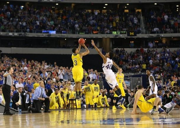 Trey Burke hits a clutch three vs. Kansas in 2013's tournament on the way to the National Championship. This year's team could do the same. Photo Credit: Matthew Emons- USA Today