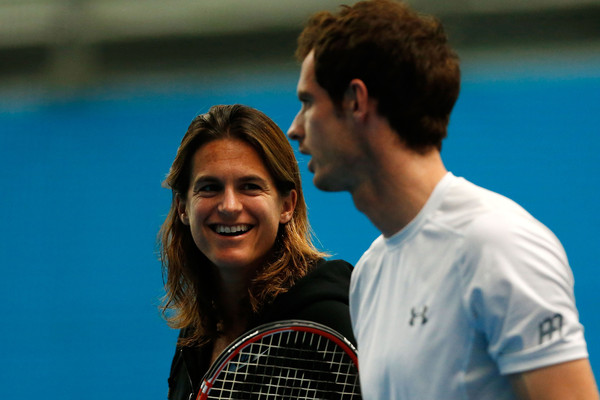 Amelie Mauresmo (left) speaks to Andy Murray during a practice at the Australian Open. Photo: Zak Kaczmarek/Getty Images
