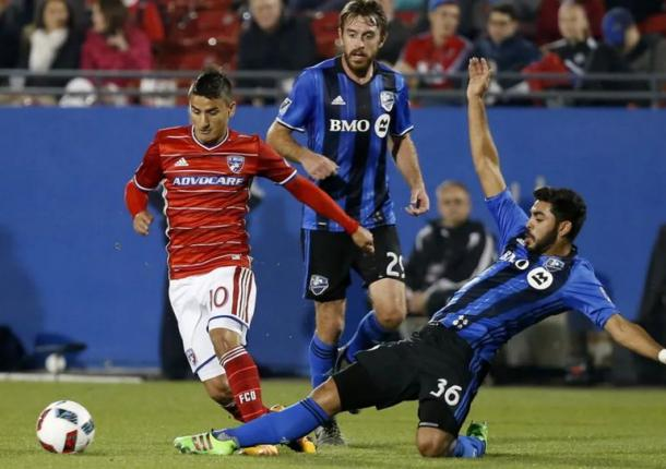 Mauro Diaz (in red, left). Photo credit: Jae S. Lee/Dallas Morning News