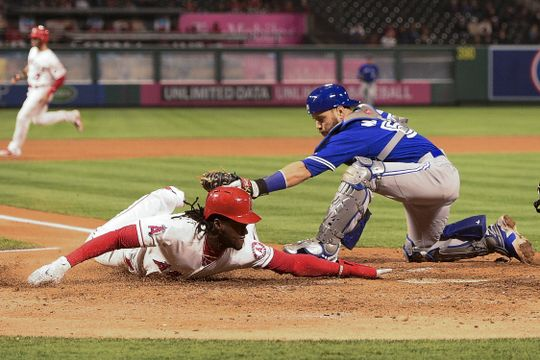 Cameron Maybin avoids tag to score go-ahead run for the Angels. | Photo: USA Today Sports