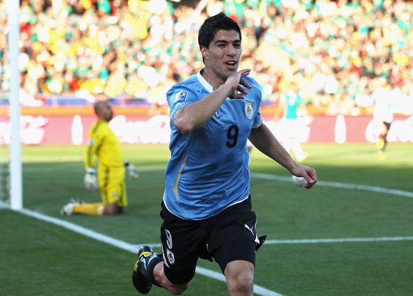 Luis Suarez celebrates scoring against Mexico in the 2010 World Cup,  expected to be the difference in this tournament he was announced as unfit to play