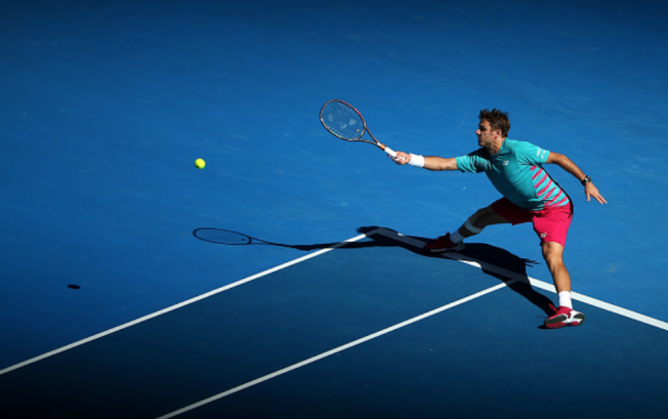 Wawrinka stretches out to return the Tsonga serve during their quarterfinal clash. Credit: Michael Dodge/Getty Images