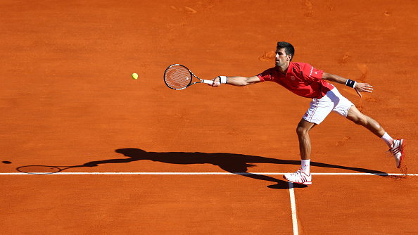 Djokovic stretches-out to return a serve in Monte Carlo. Credit: Michael Steele/Getty Images