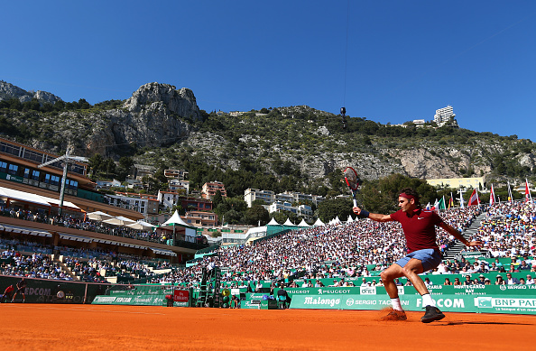 Federer follows-through after hitting a backhand. Credit: Michael Steele/Getty Images