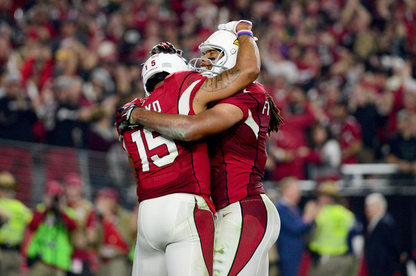 Michael Floyd and Larry Fitzgerald celebrating after a touchdown |Source: Jennifer Stewart/Getty Images North America|