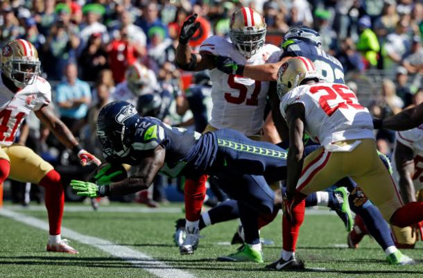 Christine Michael dives into the end zone for his second touchdown of the day against the San Francisco 49ers during week three | Source: Ted S. Warren - AP Photo