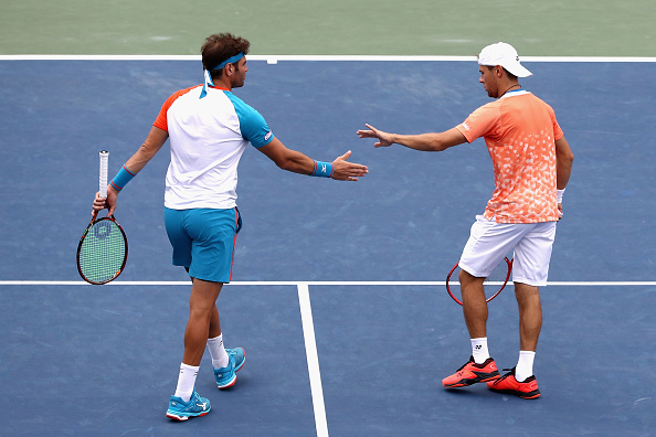 Radu Albot and Malek Jaziri high five after winning a point (Photo: Al Bello/Getty Images)