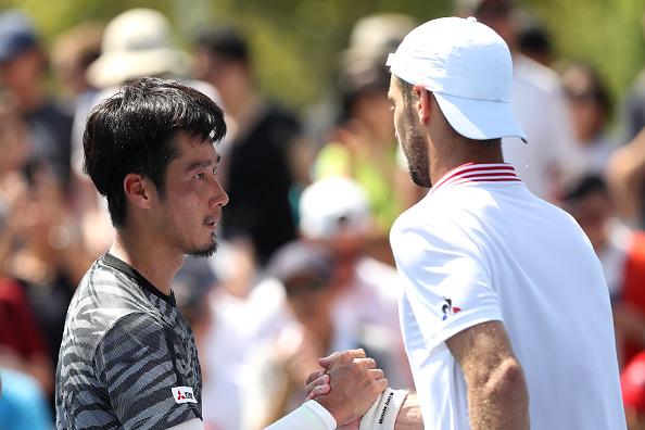Yuichi Sugita congratulates Richard Gasquet on his victory (Photo: Matthew Stockman/Getty Images)